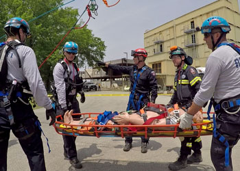 Response members transporting a victim on a stretcher