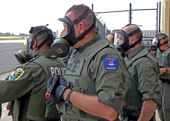 Hazmat training group of police with masks