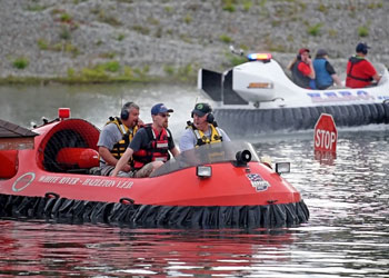 Emergency workers training on watercraft in flooded area