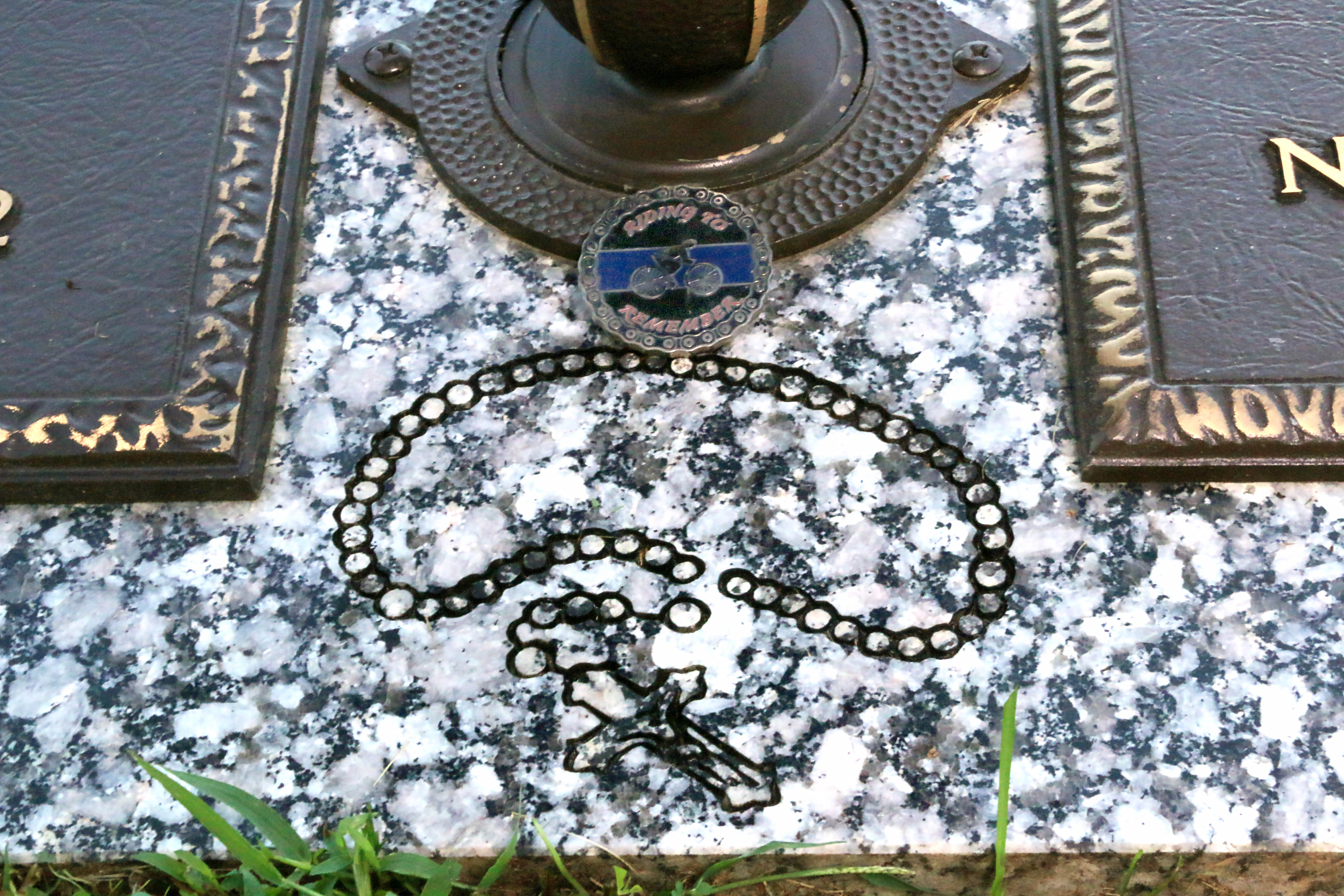 Headstone close-up - Rosary engraving